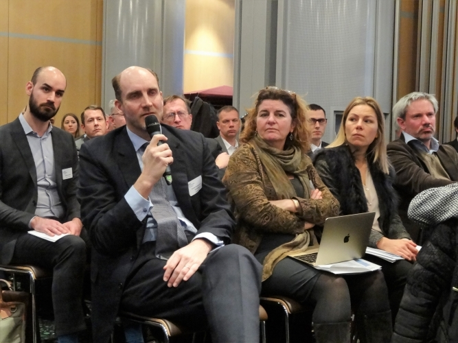 Audience addresses the speakers