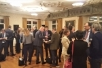Participants enjoying refreshments while networking